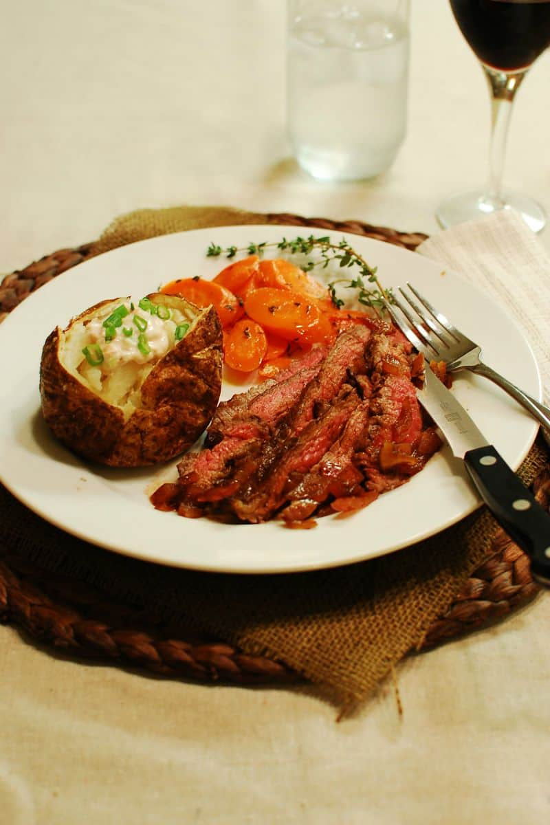 Three Pepper Flank Steak with Red Onions