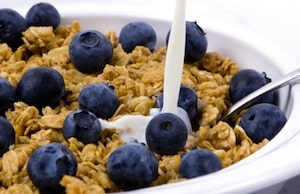 A bowl of healthy cereal with fresh blueberries