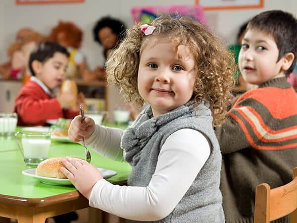 Young child Improving motor skills with family style dining