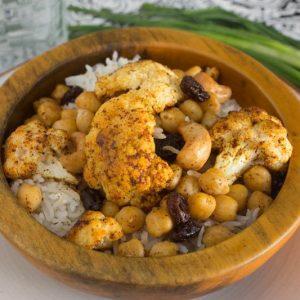 Roasted Indian Cauliflower with Chickpeas, Cashews, and Raisins