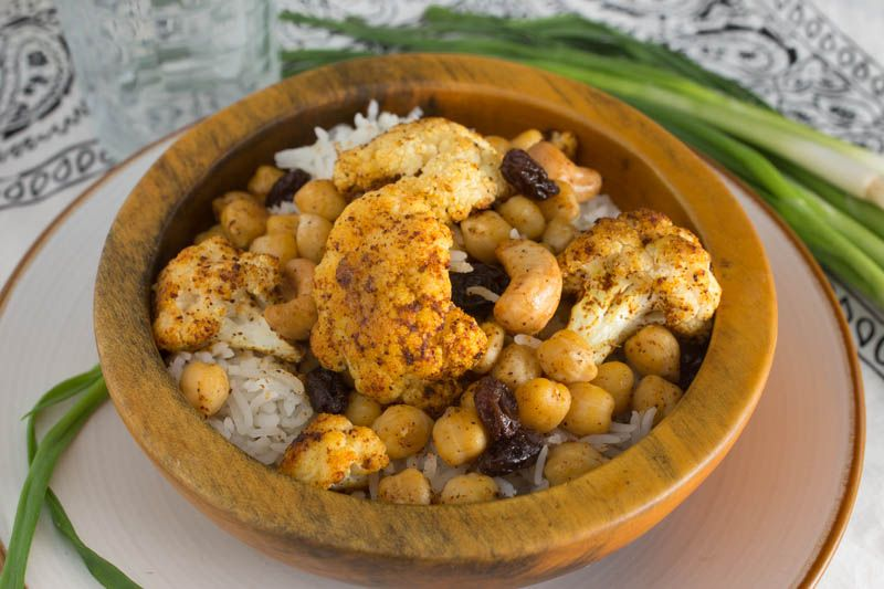 Roasted Indian Cauliflower with Chickpeas, Cashews, and Raisins