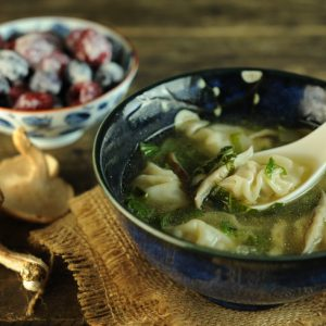 mini wonton soup with asian vegetables