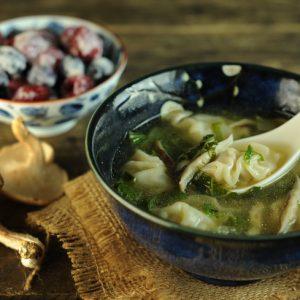mini wonton soup with asian vegetables