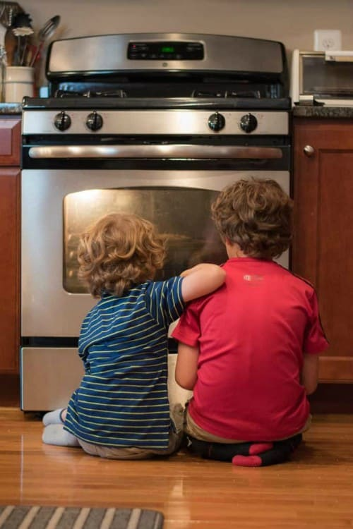 Kids watching oven